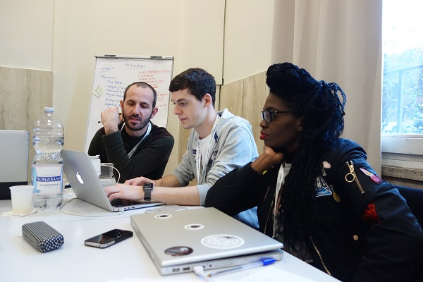 Students work in teams at the Weekend of Startups to compete for prizes