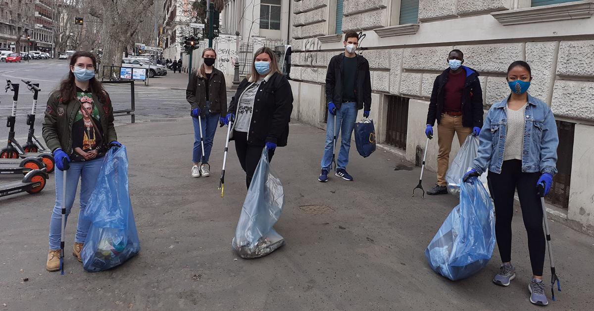 Students helping clean Trastevere picking up trash