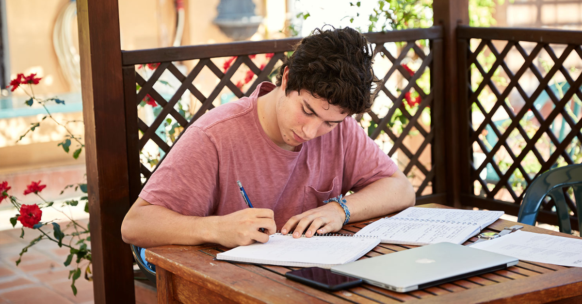 Student studying on the Secchia Terrace at John Cabot University